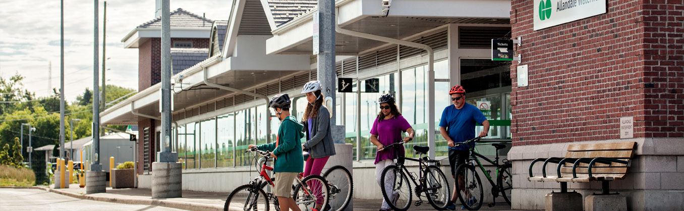 Family arriving at Go Train platform with their bikes