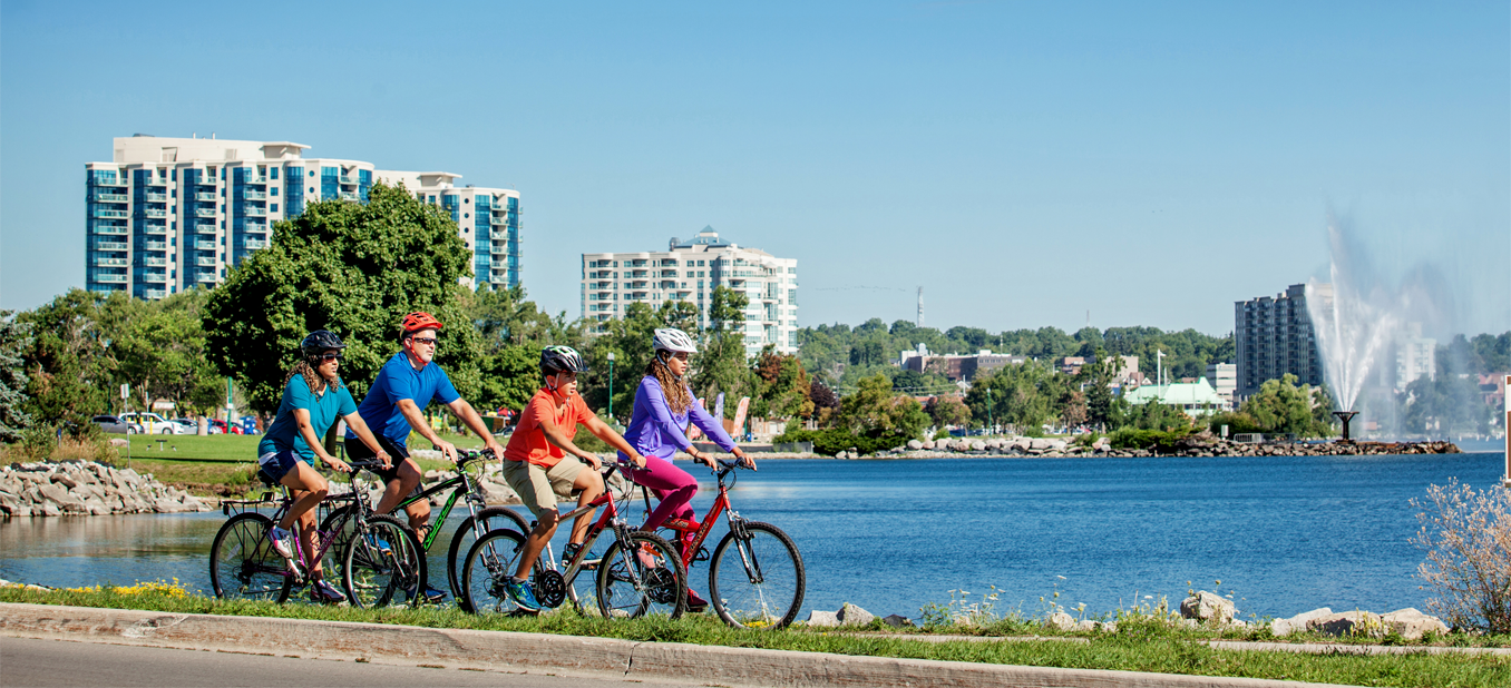 A Family of four biking along the waterfront in Barrie