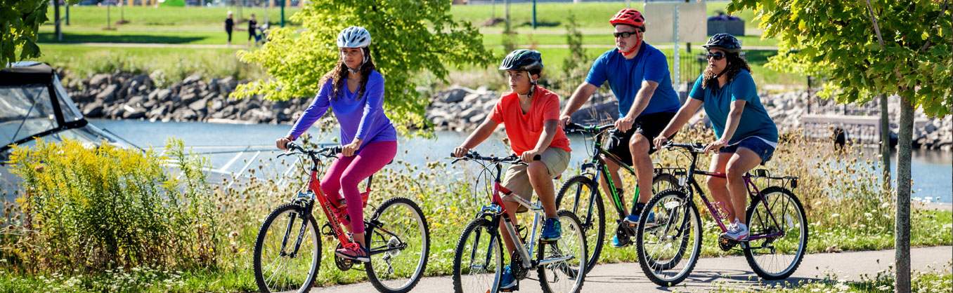 Family of four cycling along the Barrie Waterfront Trails