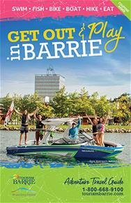 2018 Spring Barrie Adventure Guide cover featuring friends waving from a wakeboard boat