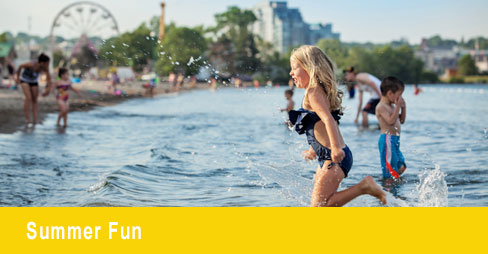 summer fun image with girl running in water