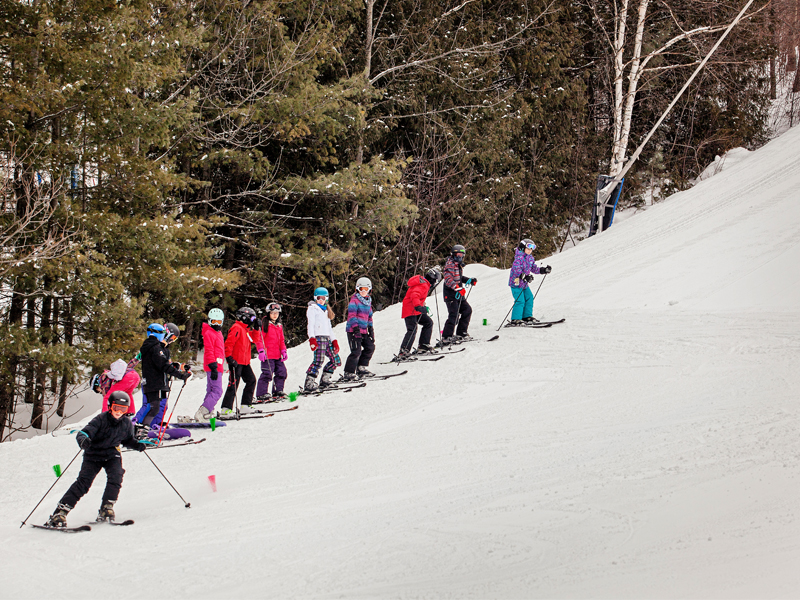 kids on hill learning to ski